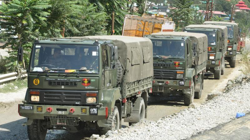 An Indian army convoy moves on the Srinagar- Ladakh highway at Gagangeer, northeast of Srinagar, Indian-controlled Kashmir. PTI Photo