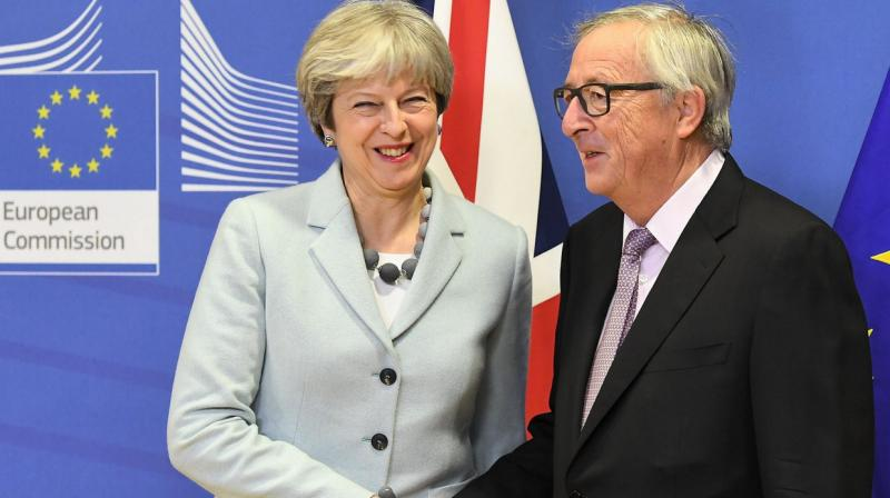 The Commission is satisfied that sufficient progress has been achieved in each of the three priority areas of citizens' rights, the dialogue on Ireland / Northern Ireland, and the financial settlement, as set out in the European Council Guidelines. (Photo: AFP)