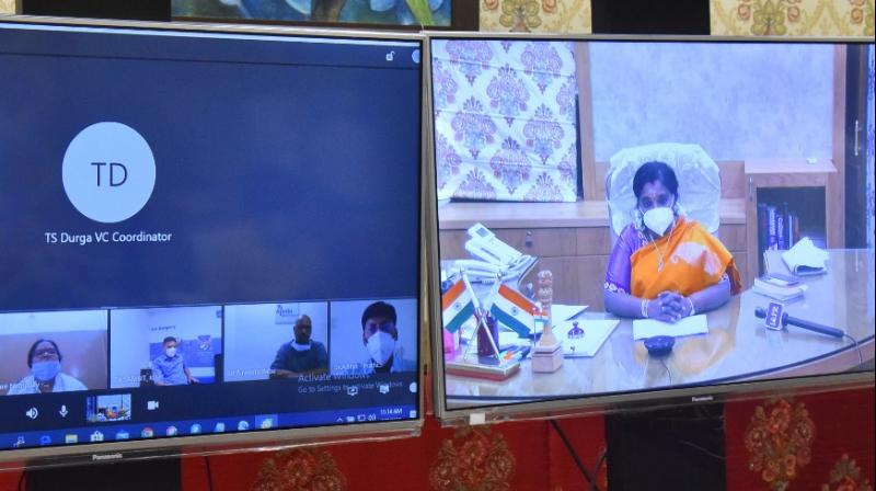 Telangana governor Tamilisai Soundararjan conducts a videoconference with hospital managements earlier this week.