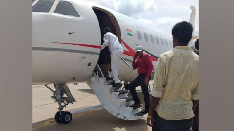 Karnataka BJP president BS Yeddyurappa's personal assistant Santosh and BJP MLA R Ashok were present with Nagaraj on the same flight which took off at 10:30 am from HAL airport. (Photo: ANI)