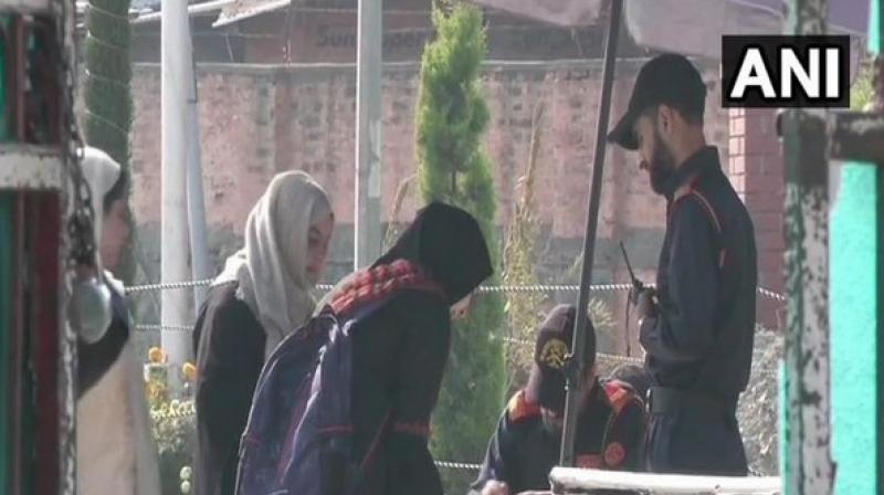 Students entering the premises of NIT Srinagar on Monday. (Photo: ANI)
