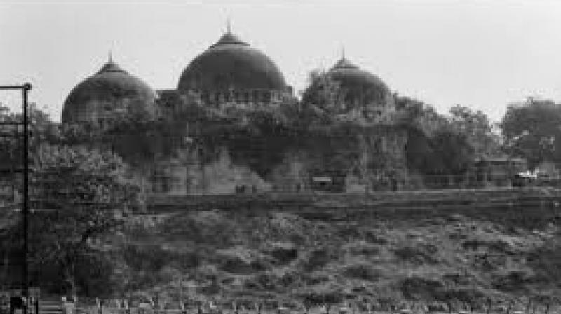 The dispute involves 2.77 acres of land in Ayodhya, which right-wing activists believe was the birthplace of Lord Ram. A 16th Century mosque - said to have been built by the Mughal Emperor Babur -- which stood at the spot was razed in December 1992 by right-wing activists. (Photo: PTI)