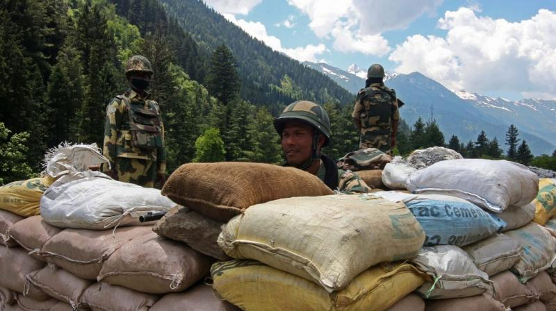 Indian border security force soldiers keep vigil near a military bunker along the Srinagar-Leh National highway on June 17, 2020. (AFP)