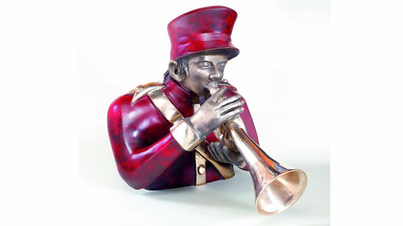 A figurine on display is inspired from Krishen Khanna's Bandwallas series