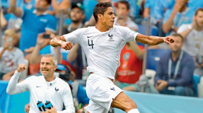 Raphael Varane of France celebrates after scoring his side's opening goal in the quarter-final against Uruguay on Friday. (Photo: AP)