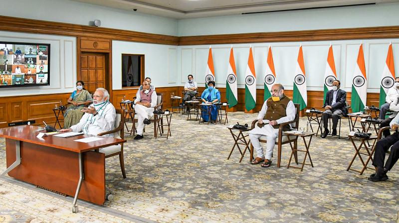 Prime minister Narendra Modi interacts with chief ministers via video conferencing to discuss the plan for tackling the COVID-19 pandemic on Monday, April 27, 2020. (PIB)