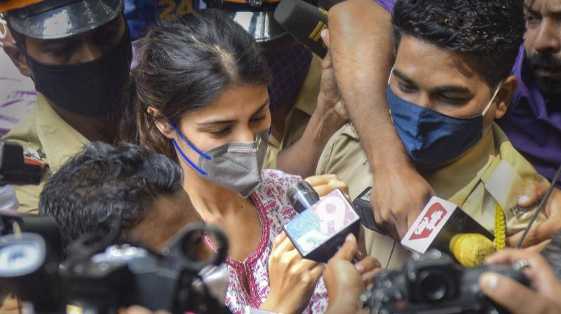 Rhea Chakraborthy being hounded by media personnel as she emerges from a grilling by the Enforcement Directorate. (PTI file photo)