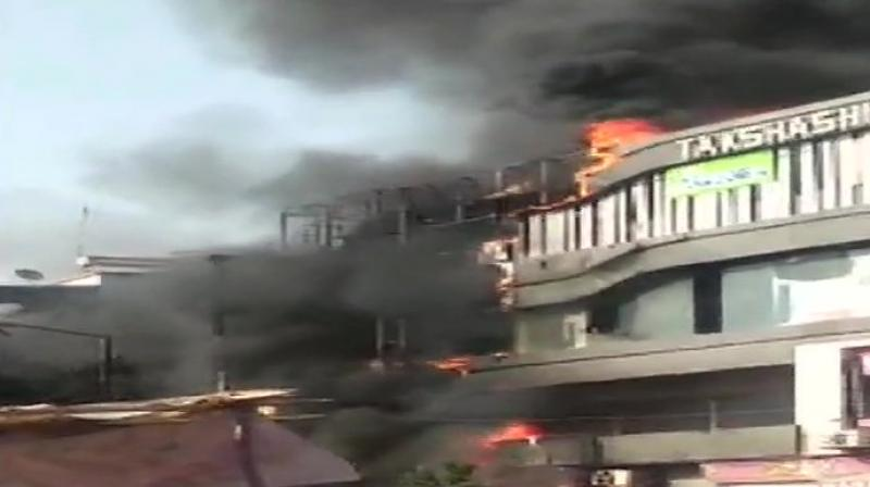 The primary reports state that the fire was caused due to short circuit and spread rapidly engulfing the entire building. (Photo: ANI Twitter)