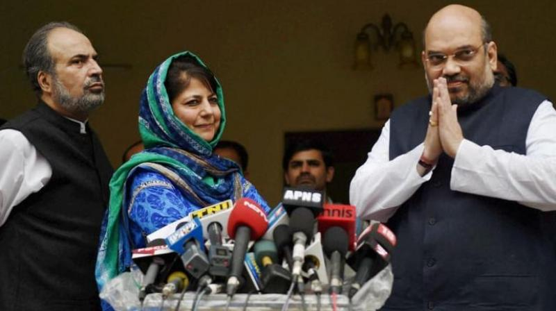 PDP President Mehbooba Mufti with BJP President Amit Shah. (Photo: PTI)