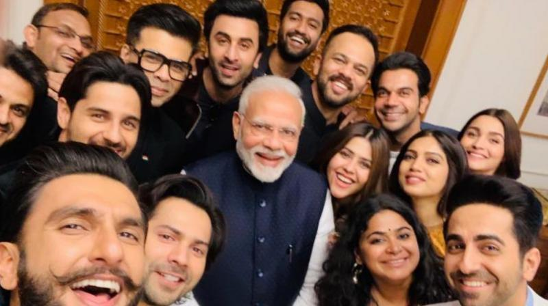 Modi with Bollywood stars.