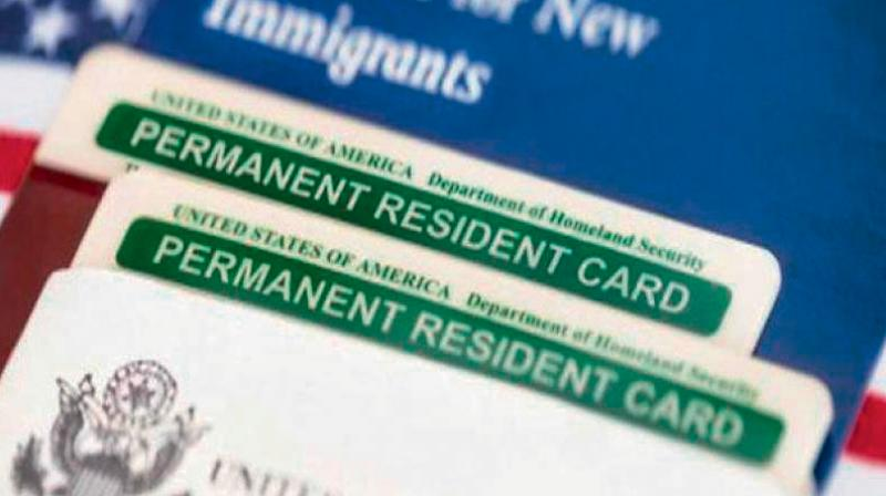 A Green Card, known officially as a Permanent Resident Card, is a document issued to immigrants as evidence that the bearer has been granted the privilege of residing permanently in the US. (DC File Image)