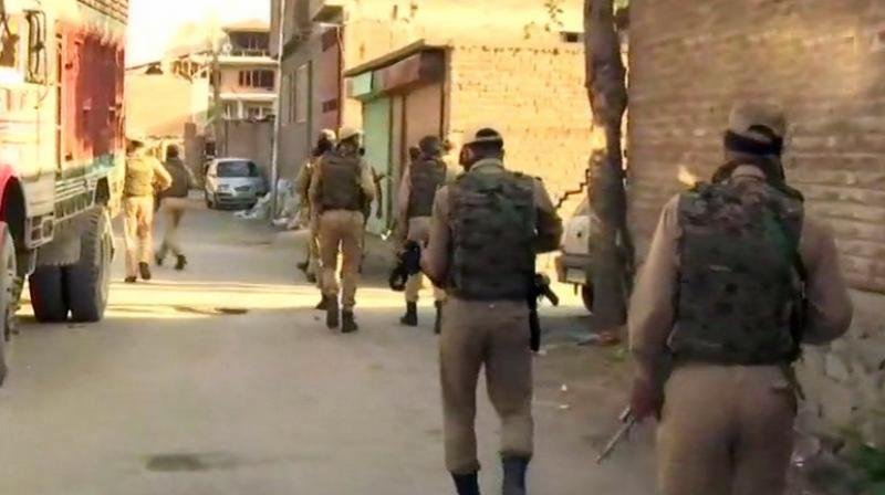 Encounter underway in Srinagar's Chattabal area where two terrorists are holed up inside a house. (Photo: ANI | Twitter)