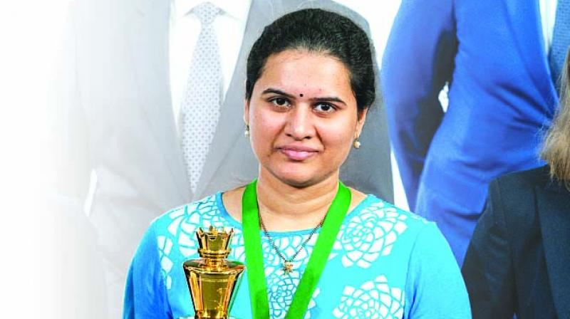 Koneru Humpy poses with her trophy after winning the World Rapid Chess Championship in Moscow.
