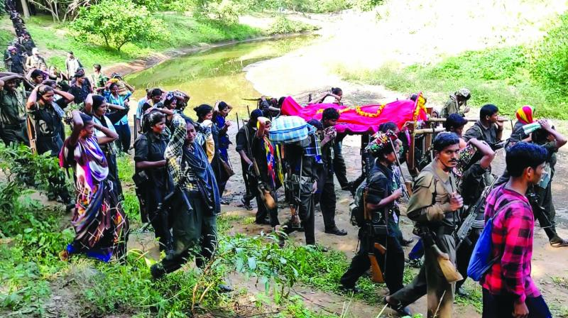 Naxal leader Ramanna's body body being taken for cremation in Bastar.