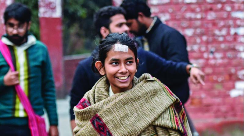 JNUSU president Aishe Ghosh on JNU Campus in New Delhi on Monday. A team of crime branch  questioned three students, including Aishe Ghosh for the January 5 violence. (Photo: PTI)