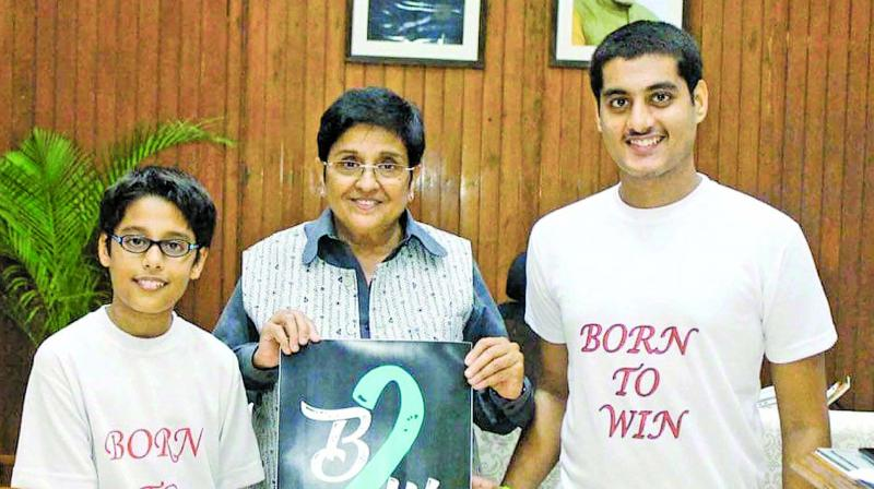 Preet, Puducherry Lt Governor Kiran Bedi and Jai Aswani during the duo's logo launch.