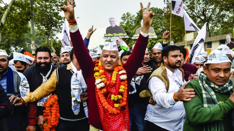 AAP leader and deputy CM Manish Sisodia along with supporters on way to file nomination papers from Patparganj Assembly constituency in New Delhi on Thursday. (Photo: PTI)