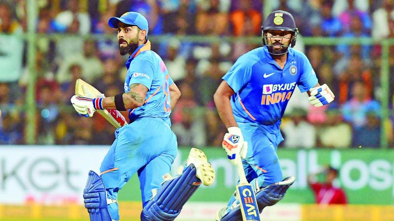 Virat Kohli and Rohit Sharma run between the  wickets during match-winning stand against Australia on Sunday. (Photo: Rajkumar Samuel)