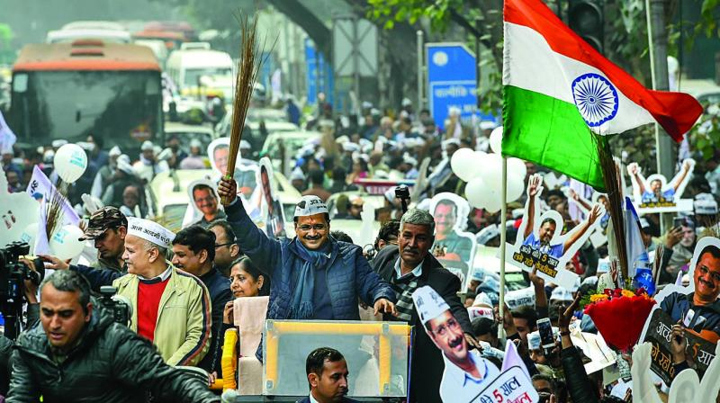Chief minister Arvind Kejriwal during a roadshow before filing his nomination papers for the Assembly polls in New Delhi on Monday. (Photo: PTI)
