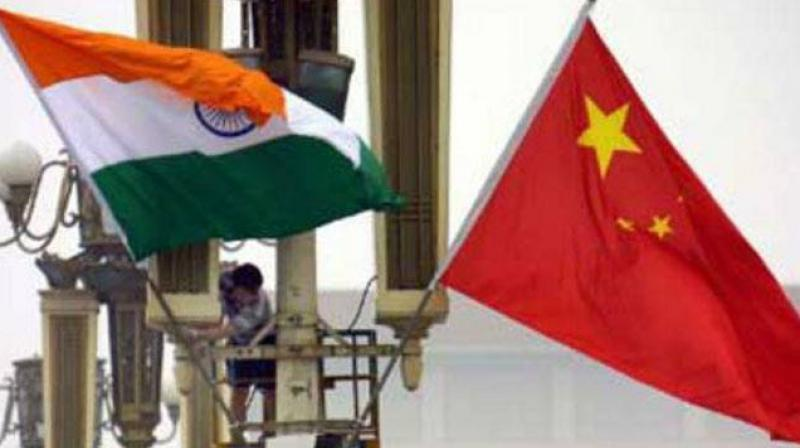 Why is China so keen to get India aboard on a project which an uncomfortable New Delhi is visibly wary of joining?
