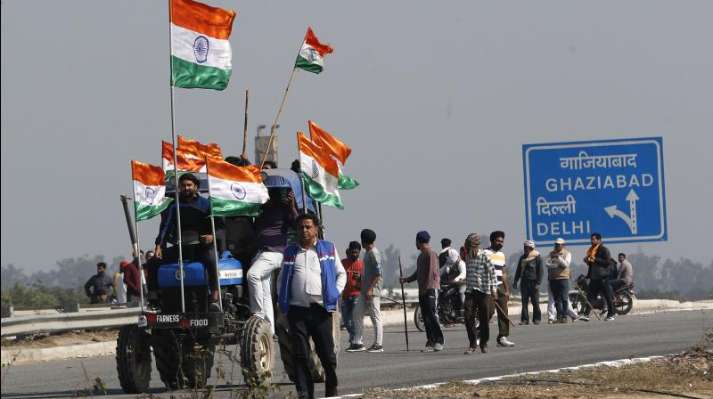 In a democracy there will be protests. Such protests, if they are allowed to linger on for so long, will attract global attention. (AP/Manish Swarup)