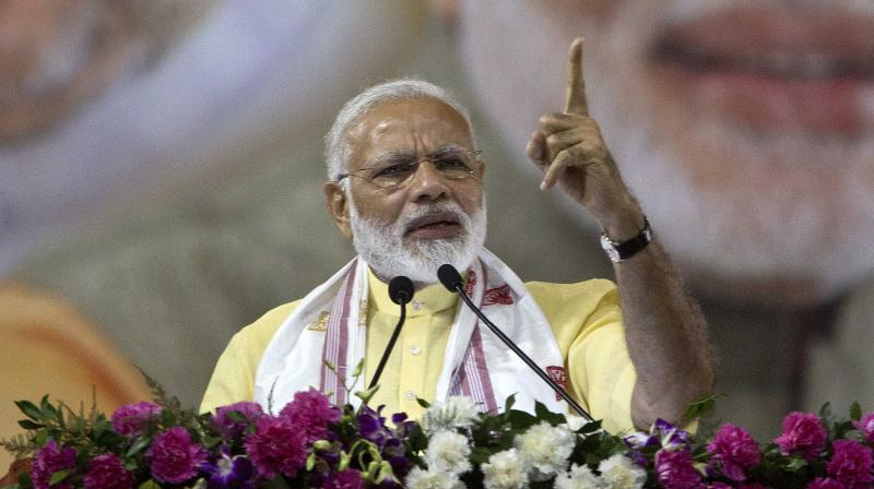 Prime Minister Narendra Modi addresses a gathering in Guwahati. (Photo: AP)