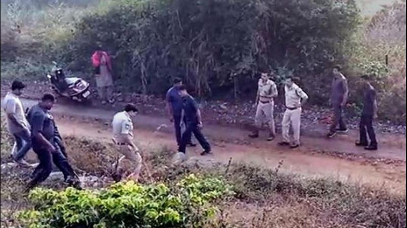 Police at the site of the alleged encounter of the four accused in the rape and murder of a veterinary on the outskirts of Hyderabad on Friday morning. (Photo: PTI)