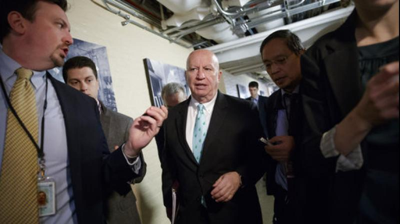 House Ways and Means Committee Chairman Rep. Kevin Brady, R-Texas, is pursued by reporters as he walks through a basement corridor on Capitol Hill in Washington. (Photo: AP)