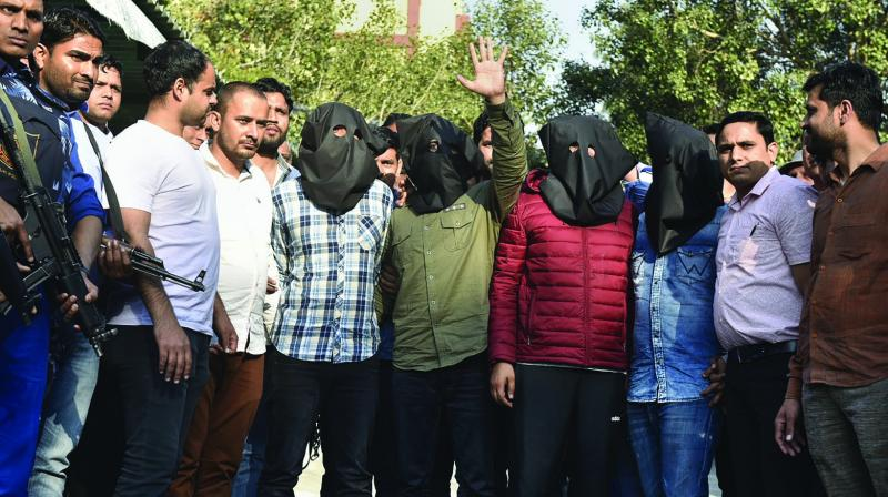 Gangster Jitender Mann alias Gogi, along with three others, at the Delhi Police headquarters on Tuesday. Haryanvi singer Harshita Dahiya. (Photo: PTI)