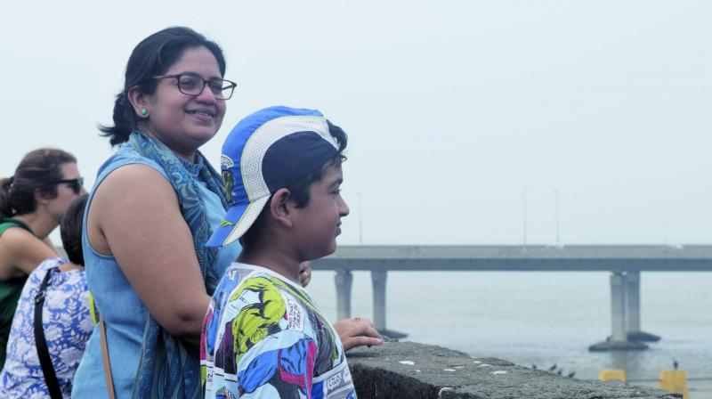 A child and parent look at the Sea Link from the fort