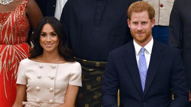 meghan markle unveils glossy new curls at buckingham palace event meghan markle unveils glossy new curls