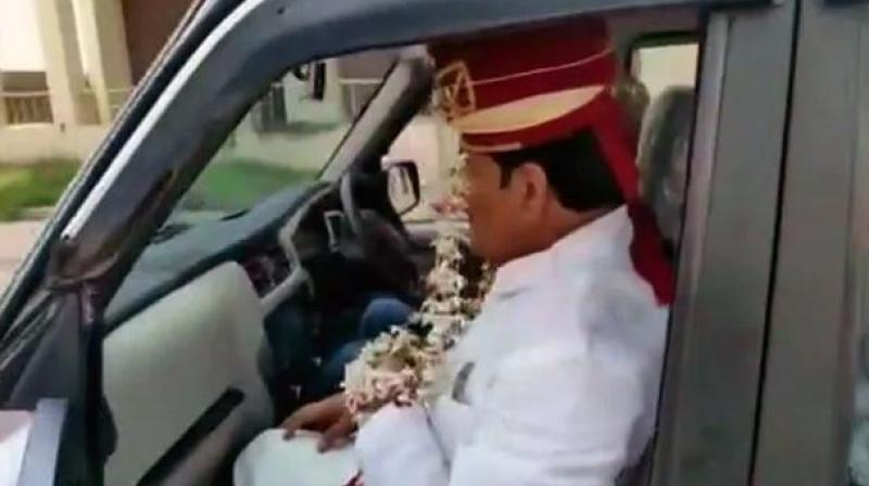 According to news agency ANI, Firoz Khan, party leader from Sambhal, wore a sehra or headdress and disguised himself as a groom to dodge the police. (Photo: ANI)