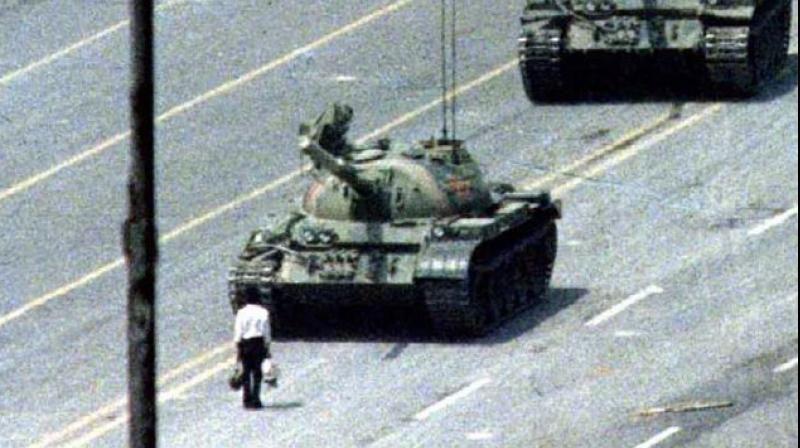 Cole won the 1990 World Press Photo award for his picture of a man in a white shirt, carrying a shopping bag in each hand, striding out into the road the day after troops killed hundreds of pro-democracy protesters in the heart of Beijing. (Photo: Social Media)