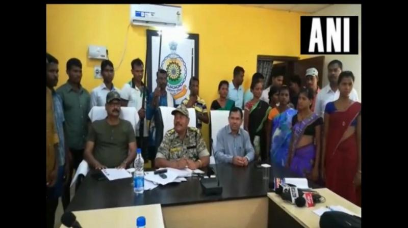 The Naxals surrendered with three rifles before Superintendent of Police, Bijapur, Gowardhan Thakur. (Photo: ANI)