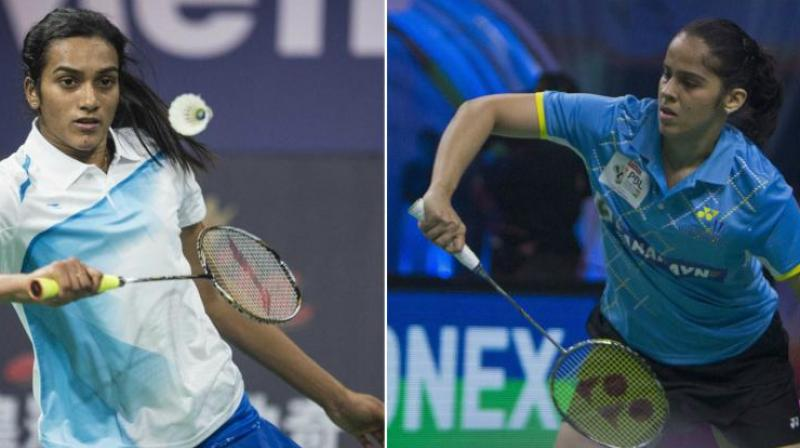 While both Sindhu and Saina held on to their places in the women's singles rankings, Mugdha Agrey and Rituparna Das climbed up six and one spot, respectively, to be placed at 62nd and 65th positions. (Photo: AFP/PTI)