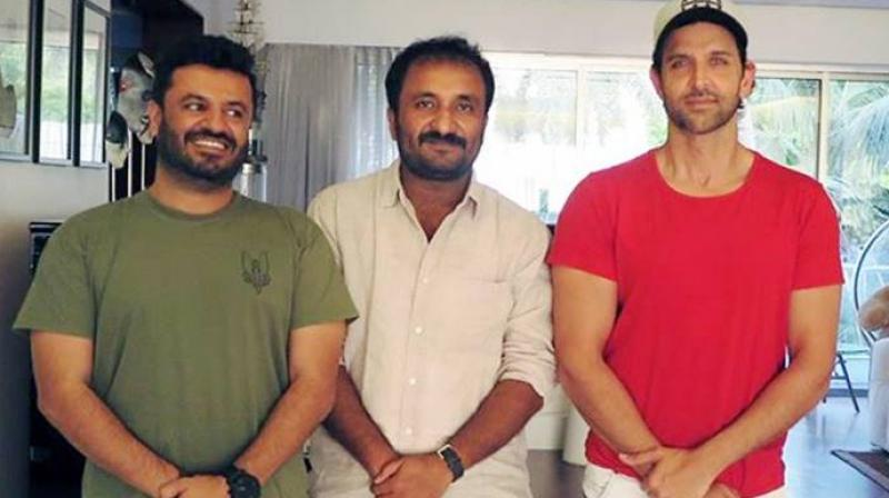 Hrithik Roshan with Anand Kumar and Vikas Bahl.