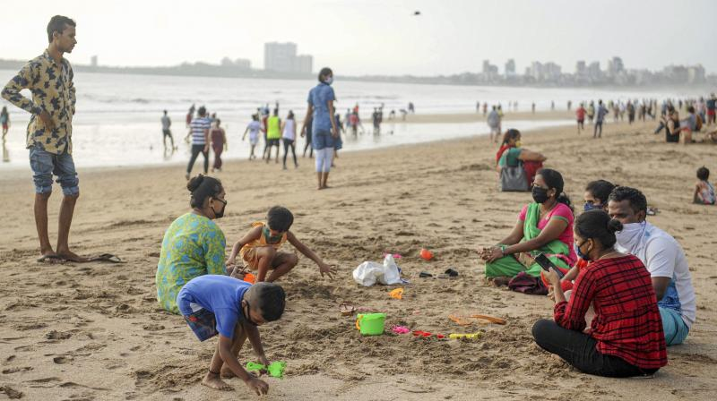 A family spends a day out at the Juhu Chowpatty in Mumbai. PTI photo
