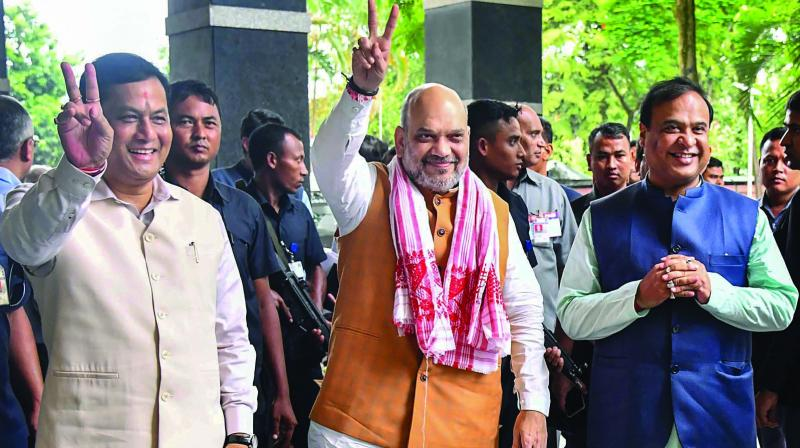 Union home minister Amit Shah with Assam CM Sarbananda Sonowal and Assam finance minister Himanta Biswa Sarma in Guwahati on Sunday. (Photo: PTI)
