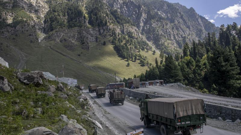 An Indian army convoy moves on the Srinagar- Ladakh highway at Gagangeer, northeast of Srinagar, Indian-controlled Kashmir. The Indian military said it apprehended a Chinese soldier Monday, Oct. 19, in the remote Ladakh region, where the two countries are locked in a monthslong military standoff along their disputed border. (AP)
