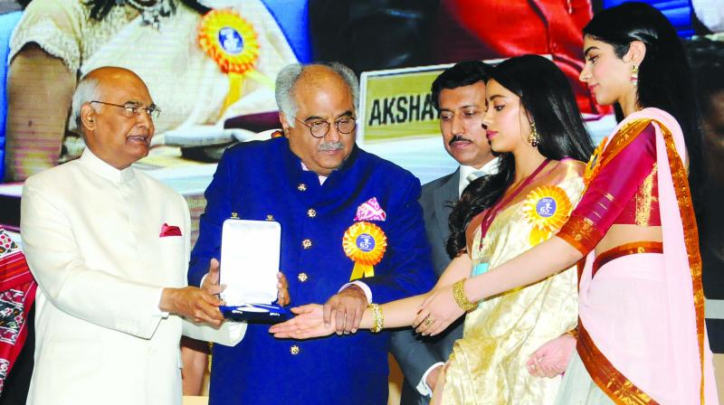 President Ram Nath Kovind confers Best Actress Award on veteran actress Sridevi (posthumously). The award was received by her husband Boney Kapoor and daughters Janhvi and Khushi, during the 65th National Film Awards function at Vigyan Bhavan in New Delhi on Thursday. MoS for I&B Rajyavardhan Rathore is also seen. (Photo: G.N. Jha)