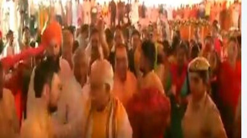 Video footage, which has surfaced on social media platforms, also shows that before taking a selfie, the youth touched Khattar's feet to seek his blessings. (Photo: Screengrab)