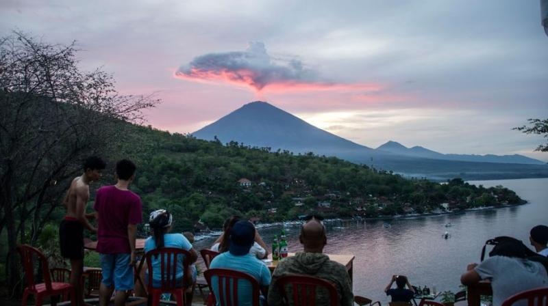 Tourists gather to watch Mount Agung at Amed beach in Karangasem on Indonesia's resort island of Bali last week. (Phot: AFP/ File)