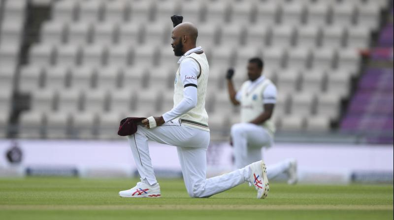 West Indies' captain Jasion Holder, second left, and teammates take a knee in support of the Black Lives Matter movement before the start of the first day of the 1st cricket Test match between England and West Indies. AFP Photo