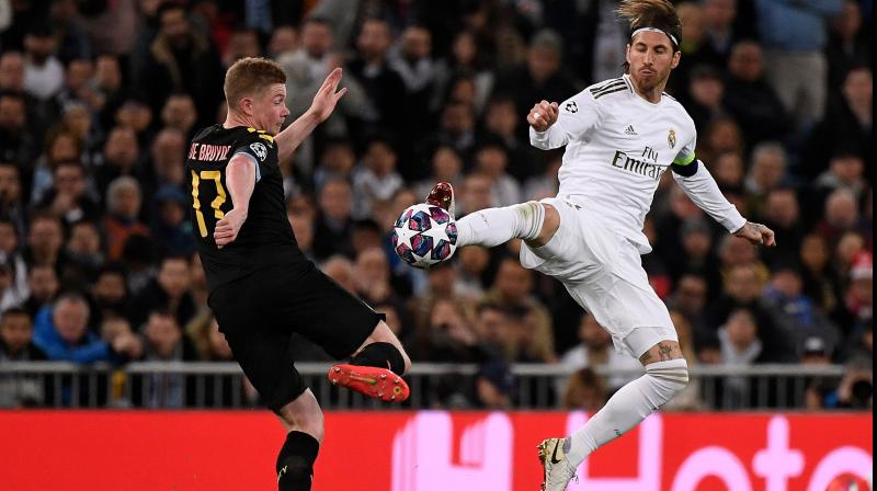 Real Madrid's Spanish defender Sergio Ramos (right) challenges Manchester City's Belgian midfielder Kevin De Bruyne during the UEFA Champions League round of 16 first-leg football match between Real Madrid and Manchester City at the Santiago Bernabeu stadium in Madrid on February 26, 2020. (AFP)