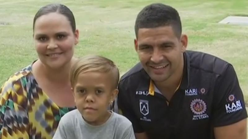 In this photo taken from video provided by the Australian Broadcasting Corporation, Quaden Bayles (centre), his mother Yarraka Bayles, and Cody Walker, a professional rugby league player, pose together Friday, February 21, 2020, in Gold Coast, Australia. Bayles, who has dwarfism, received an outpouring of support worldwide after his mother shared an emotional clip of him on social media. (AP)