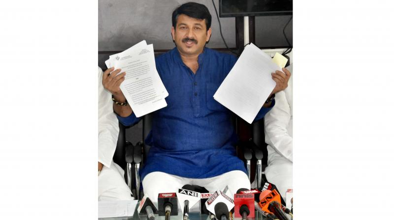Delhi BJP's president Manoj Tiwari demands immediate dismissal of 21 AAP MLAs who have been charged with holding defacto 'óffice of profit', at a press conference, in New Delhi. (PTI)