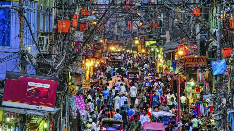 """""""The number of cables keeps increasing with the number of shops here. The web of overhead wires keeps getting thicker and in turn the power load increases,"""" said a trader from the area."""