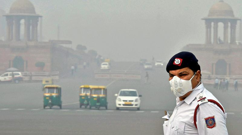 A traffic policeman, wearing an anti-pollution mask,controls traffic amid smog and air pollution which continues to be above dangerous level. (Representational image)