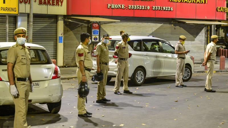 Police officials seal the Bengali market area after a case of coronavirus was reported in New Delhi. PTI photo