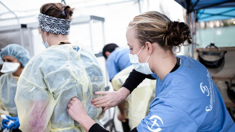 Medical workers putting on PPEs at the beginning of their shift at the emergency field hospital run by Samaritan's Purse and Mount Sinai Health System in Central Park, New York. AFP photo